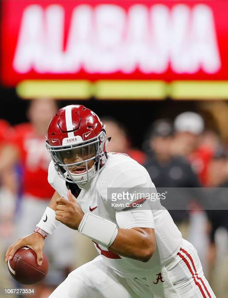 Jalen Hurts of the Alabama Crimson Tide scrambles in the fourth quarter against the Georgia Bulldogs during the 2018 SEC Championship Game at...