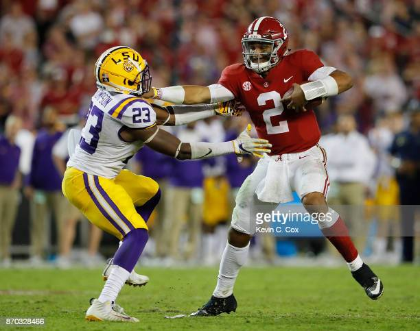 Jalen Hurts of the Alabama Crimson Tide stiff arms Corey Thompson of the LSU Tigers at BryantDenny Stadium on November 4 2017 in Tuscaloosa Alabama