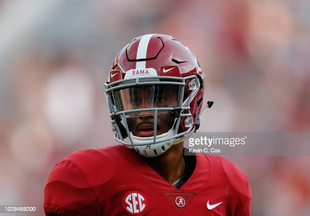 Jalen Hurts of the Alabama Crimson Tide walks off the field after a touchdown by Najee Harris against the Arkansas State Red Wolves at BryantDenny...