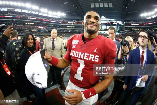 Jalen Hurts of the Oklahoma Sooners celebrates the team's win over the Baylor Bears following the Big 12 Football Championship at AT&T Stadium on...