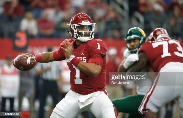 Jalen Hurts of the Oklahoma Sooners looks to pass the ball against the Baylor Bears in the first quarter of the Big 12 Football Championship at ATT...
