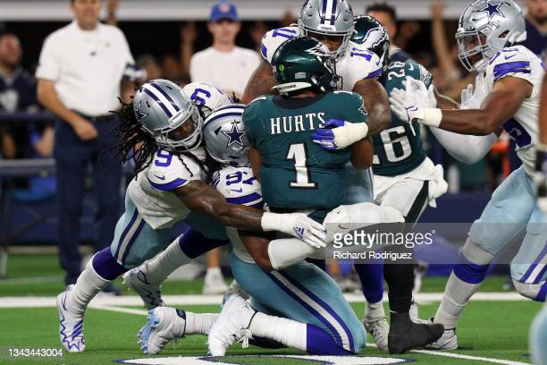 Jalen Hurts of the Philadelphia Eagles is sacked buy the Dallas Cowboys defense in the second half at AT&T Stadium on September 27, 2021 in...