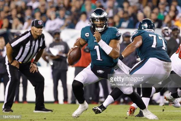 Jalen Hurts of the Philadelphia Eagles looks for a teammate against the Tampa Bay Buccaneers at Lincoln Financial Field on October 14, 2021 in...