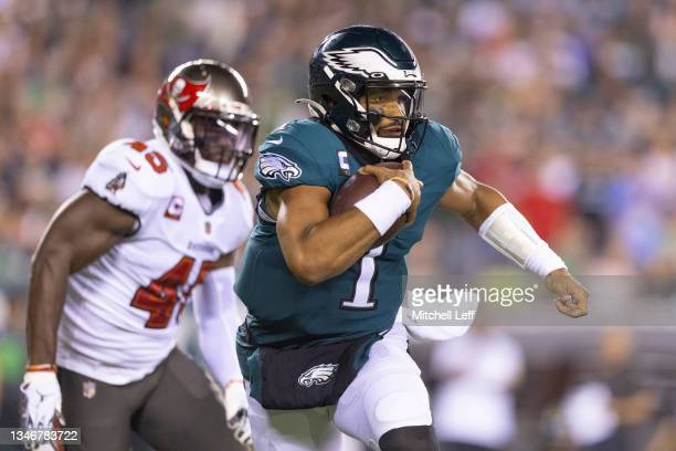 Jalen Hurts of the Philadelphia Eagles runs the ball against Devin White of the Tampa Bay Buccaneers at Lincoln Financial Field on October 14, 2021...