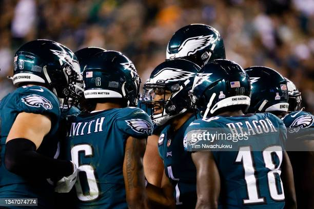 Jalen Hurts of the Philadelphia Eagles speaks to teammates against the Tampa Bay Buccaneers at Lincoln Financial Field on October 14, 2021 in...