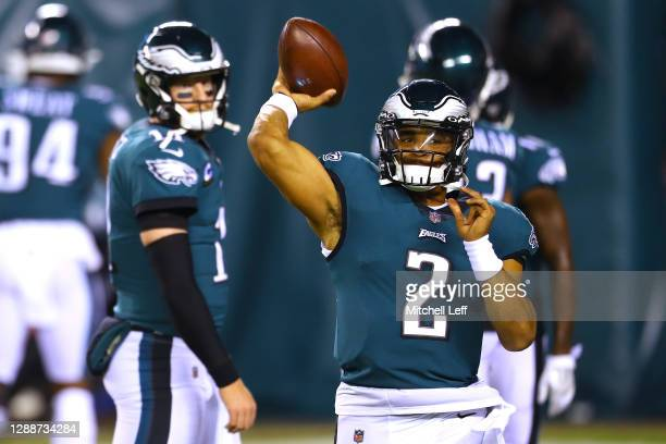 Jalen Hurts warms up as Carson Wentz of the Philadelphia Eagles looks on against the Seattle Seahawks at Lincoln Financial Field on November 30, 2020...