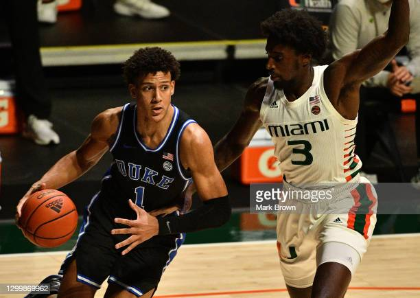 Jalen Johnson of the Duke Blue Devils drives to the basket against Nysier Brooks of the Miami Hurricanes during the first half at Watsco Center on...