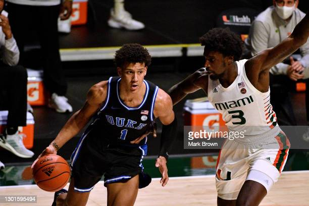 Jalen Johnson of the Duke Blue Devils drives to the basket against the Nysier Brooks of the Miami Hurricanes during the first half at Watsco Center...