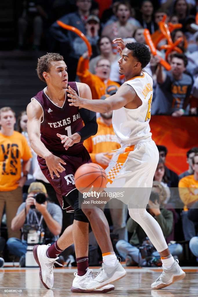 Jalen Johnson #13 of the Tennessee Volunteers defends against DJ Hogg #1 of the Texas A&M Aggies in the first half of a game at Thompson-Boling Arena on January 13, 2018 in Knoxville, Tennessee. Tennessee won 75-62.