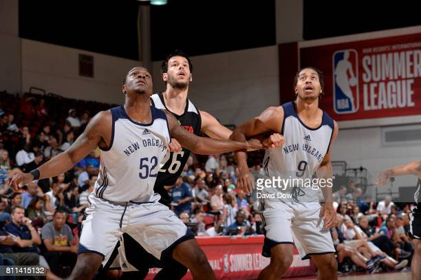 Jalen Jones and Isaiah Cousins of the New Orleans Pelicans box out Duje Dukan of the Atlanta Hawks on July 9 2017 at the Cox Pavilion in Las Vegas...