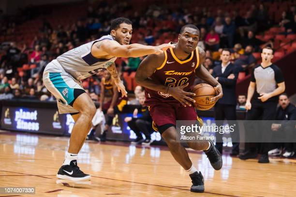 Jalen Jones of the Canton Charge drives to the basket through coverage by Isaiah Wilkins of the Greensboro Swarm on December 15 2018 at the Canton...