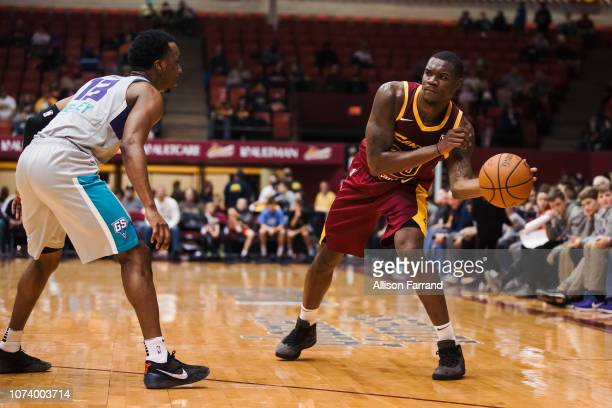 Jalen Jones of the Canton Charge passes around Joe Chealey of the Greensboro Swarm on December 15 2018 at the Canton Memorial Civic Center in Canton...