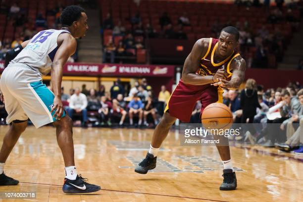 Jalen Jones of the Canton Charge passes to a teammates around Joe Chealey of the Greensboro Swarm on December 15 2018 at the Canton Memorial Civic...