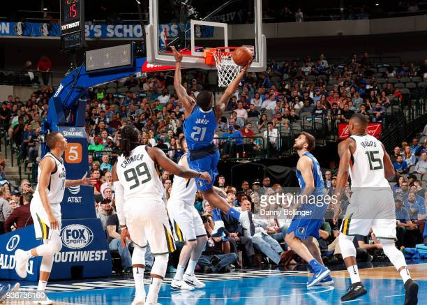 Jalen Jones of the Dallas Mavericks dunks the ball during the game against the Utah Jazz on March 22 2018 at the American Airlines Center in Dallas...