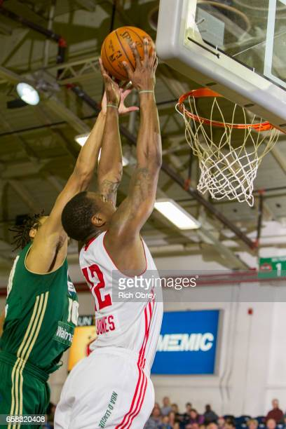 Jalen Jones of the Maine Red Claws is fouled by Isaiah Cousins of the Reno Bighorns on Sunday March 26 2017 at the Portland Expo in Portland Maine...