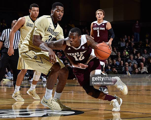 Jalen Jones of the Texas AM Aggies drives into Damian Jones of the Vanderbilt Commodores during the first half at Memorial Gym on February 4 2016 in...