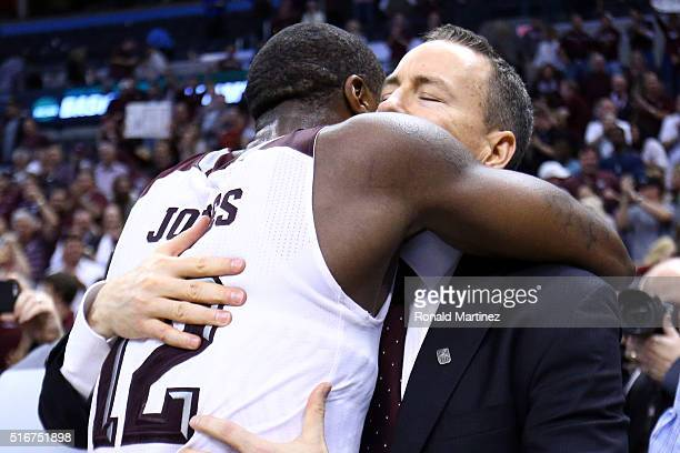 Jalen Jones of the Texas A&M Aggies hugs head coach Billy Kennedy after defeating the Northern Iowa Panthers in double overtime with a score of 88 to...