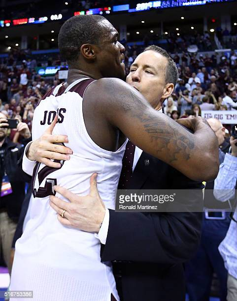 Jalen Jones of the Texas AM Aggies hugs head coach Billy Kennedy after defeating the Northern Iowa Panthers in double overtime with a score of 88 to...