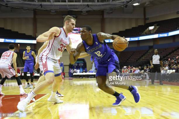 Jalen Jones of the Texas Legends handles the ball against Austin Nichols of the Memphis Hustle during an NBA GLeague game on January 29 2018 at...