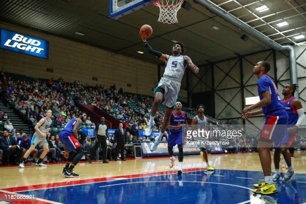 Jalen McDaniels of the Greensboro Swarm goes to the basket against the Grand Rapids Drive during the first quarter of an NBA G-League game on...