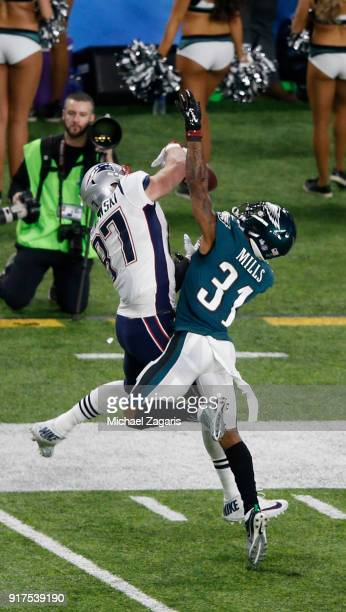 Jalen Mills of the Philadelphia Eagles breaks up a pass to Rob Gronkowski of the New England Patriots in Super Bowl LII at US Bank Stadium on...