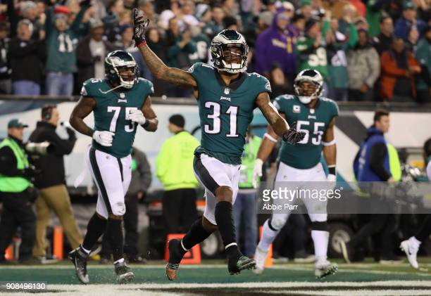 Jalen Mills of the Philadelphia Eagles celebrates a first quarter touchdown by teammate Patrick Robinson against the Minnesota Vikings in the NFC...