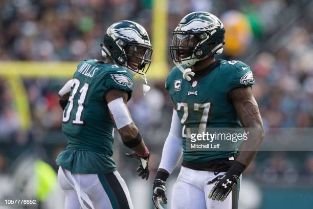 Jalen Mills of the Philadelphia Eagles celebrates with Malcolm Jenkins against the Carolina Panthers at Lincoln Financial Field on October 21 2018 in...