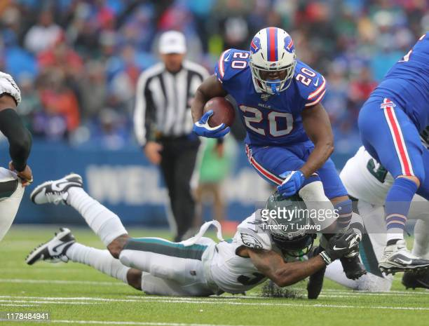 Jalen Mills of the Philadelphia Eagles dives to tackle Devin Singletary of the Buffalo Bills as he runs the ball during the second half at New Era...