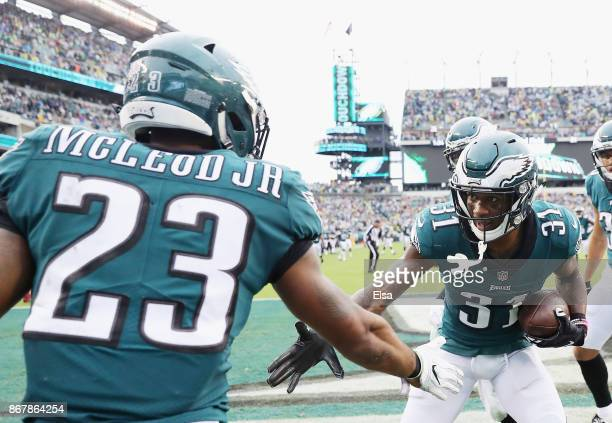 Jalen Mills of the Philadelphia Eagles is congratulated by teamamte Rodney McLeod after Mills intercepted a pass by CJ Beathard of the San Francisco...