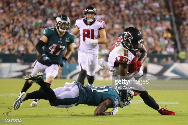 Jalen Mills of the Philadelphia Eagles tackles Julio Jones of the Atlanta Falcons during the fourth quarter at Lincoln Financial Field on September 6...