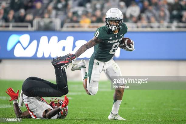 Jalen Nailor of the Michigan State Spartans runs the ball against Davion Williams of the Western Kentucky Hilltoppers during the fourth quarter of...