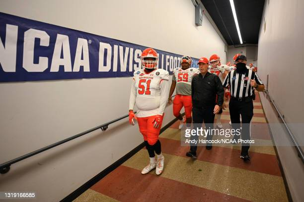 Jalen North of the Sam Houston State Bearkats and head coach K. C. Keeler of the Sam Houston State Bearkats exits the locker room before the game...