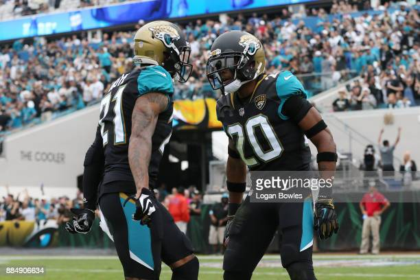 Jalen Ramsey and AJ Bouye of the Jacksonville Jaguars celebrate after Ramsey had an interception in the first half of their game against the...