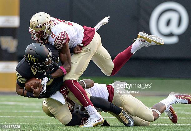 Jalen Ramsey and Keelin Smith of the Florida State Seminoles sack Kendall Hinton of the Wake Forest Demon Deacons during their game at BBT Field on...