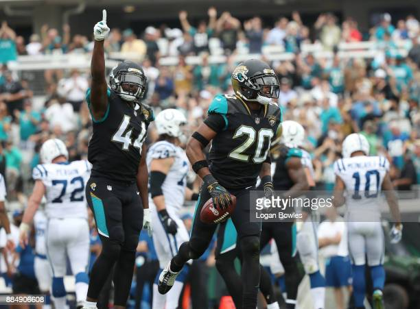 Jalen Ramsey and Myles Jack of the Jacksonville Jaguars celebrate after Ramsey had an interception in the first half of their game against the...