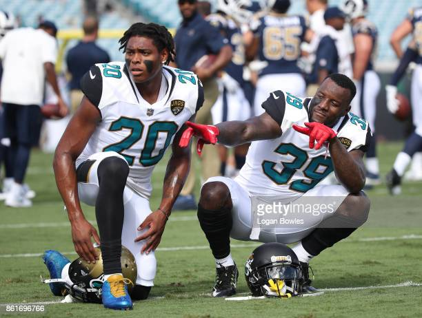 Jalen Ramsey and Tashaun Gipson of the Jacksonville Jaguars wait on the field prior to the start of their game against the Los Angeles Rams at...