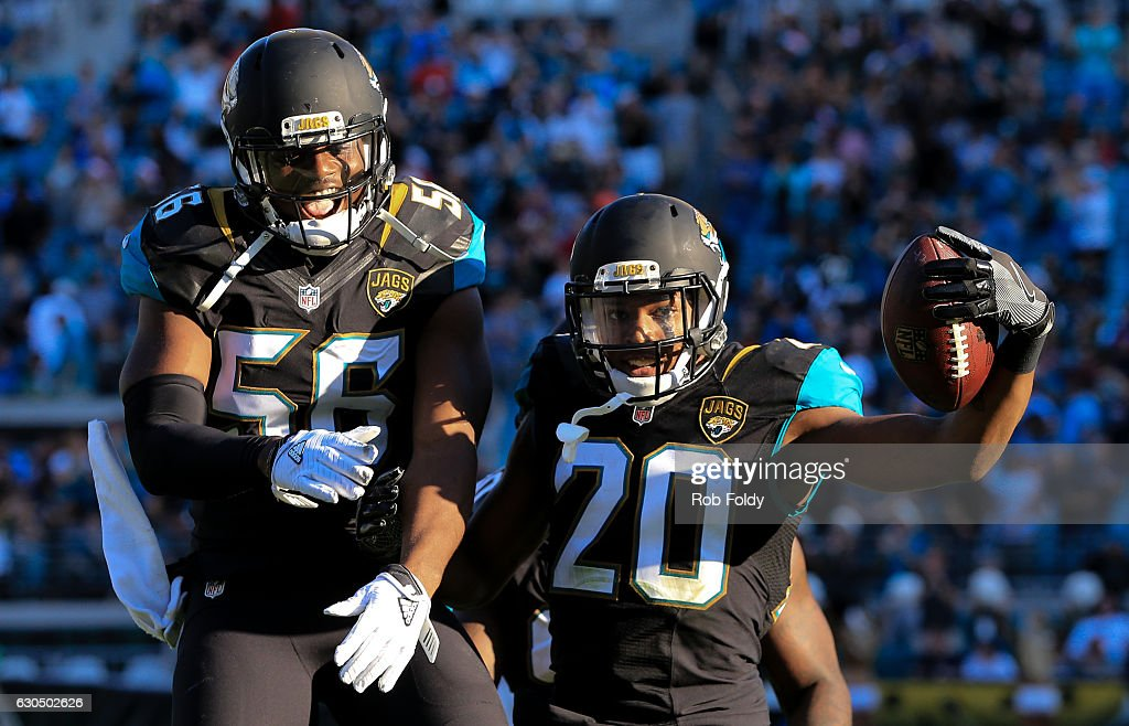 Jalen Ramsey #20 celebrates with Dante Fowler #56 after running an interception back for a touchdown during the fourth quarter of the game against the Tennessee Titans at EverBank Field on December 24, 2016 in Jacksonville, Florida.