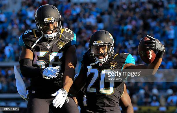 Jalen Ramsey celebrates with Dante Fowler after running an interception back for a touchdown during the fourth quarter of the game against the...