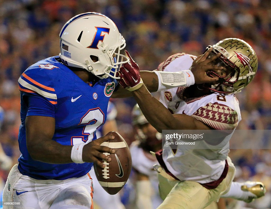 Jalen Ramsey #8 of the Florida State Seminoles attempts to tackle Treon Harris #3 of the Florida Gators during the game at Ben Hill Griffin Stadium on November 28, 2015 in Gainesville, Florida.