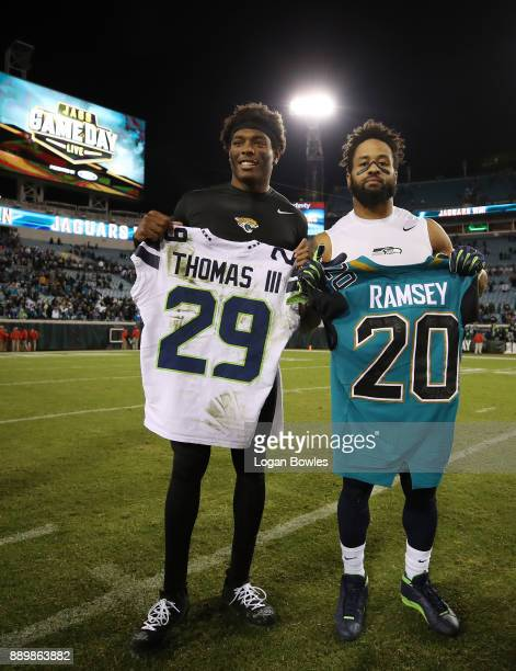 Jalen Ramsey of the Jacksonville Jaguars and Earl Thomas of the Seattle Seahawks exchange jerseys on the field after the Jaguars defeated the...