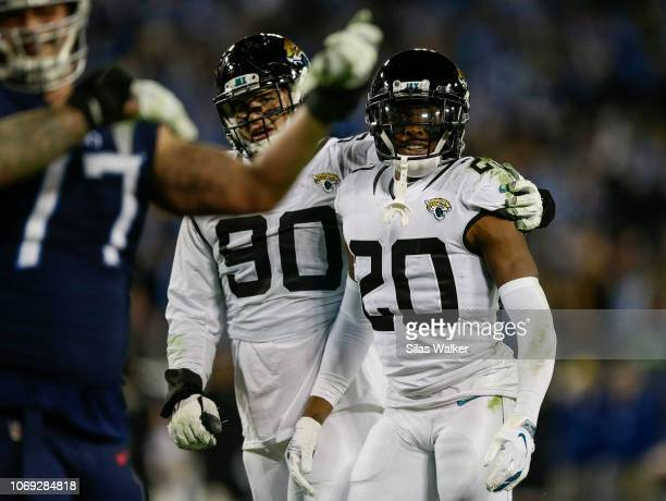 Jalen Ramsey of the Jacksonville Jaguars and Taven Bryan watches Taylor Lewan of the Tennessee Titans after a confrontation during the fourth quarter...