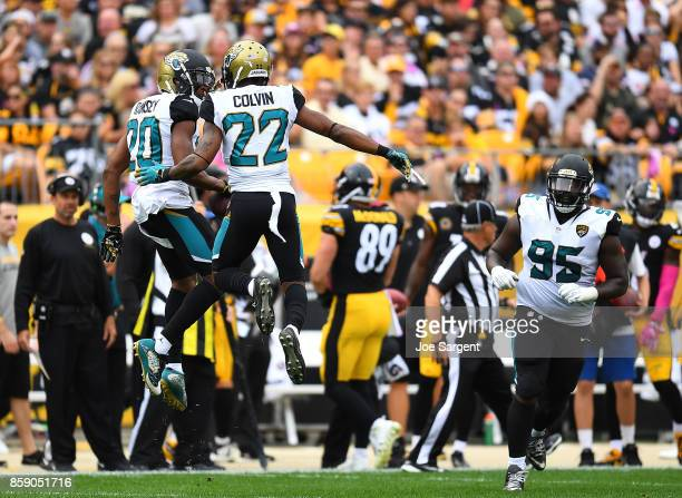 Jalen Ramsey of the Jacksonville Jaguars celebrates with Aaron Colvin after intercepting a pass intended for Vance McDonald of the Pittsburgh...