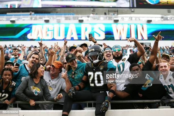 Jalen Ramsey of the Jacksonville Jaguars celebrates with fans after the Jaguars defeated the Indianapolis Colts 3010 at EverBank Field on December 3...