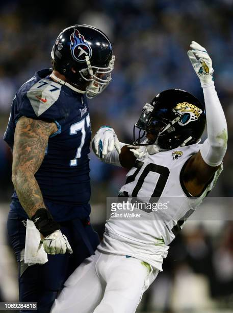 Jalen Ramsey of the Jacksonville Jaguars falls after being confronted by Taylor Lewan of the Tennessee Titans after tackling Derrick Henry during the...