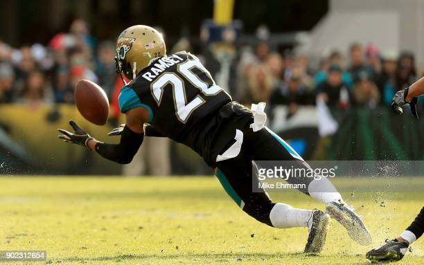 Jalen Ramsey of the Jacksonville Jaguars makes an interception during AFC Wild Card playoff game against the Buffalo Bills at EverBank Field on...