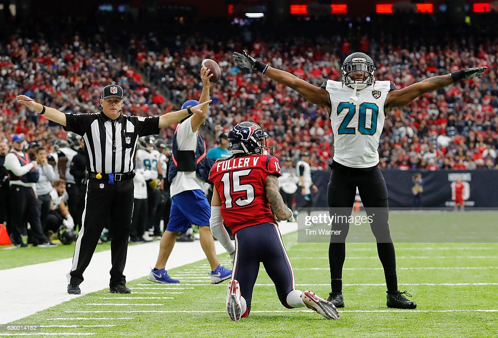 Jalen Ramsey #20 of the Jacksonville Jaguars signals incomplete after defending Will Fuller #15 of the Houston Texans in the fourth quarter at NRG Stadium on December 18, 2016 in Houston, Texas.