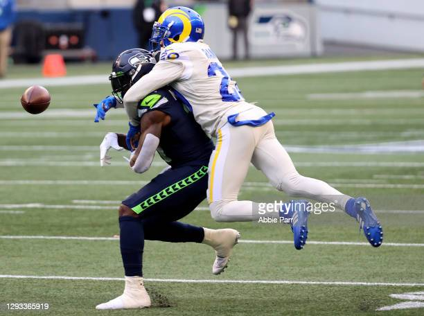 Jalen Ramsey of the Los Angeles Rams breaks up a pass intended for DK Metcalf of the Seattle Seahawks during the second quarter at Lumen Field on...