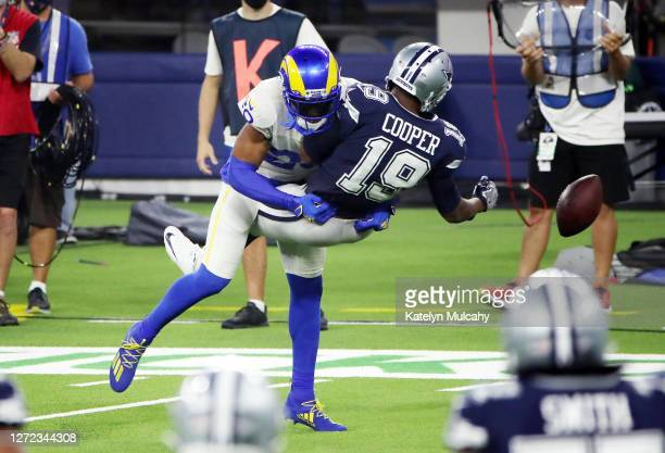 Jalen Ramsey of the Los Angeles Rams breaks up a pass intended for Amari Cooper of the Dallas Cowboys during the fourth quarter at SoFi Stadium on...