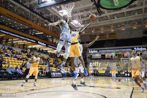 Jalen Ray of the Hofstra Pride takes a shot over Deshaun Morman of the Towson Tigers during a college basketball game at SECU Arena on January 11...