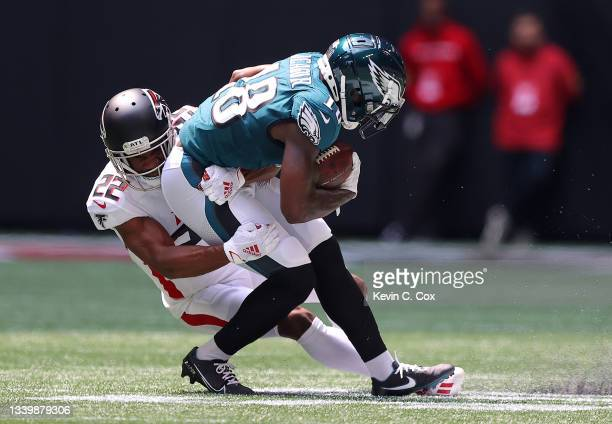 Jalen Reagor of the Philadelphia Eagles is tackled by Fabian Moreau of the Atlanta Falcons during the second quarter at Mercedes-Benz Stadium on...